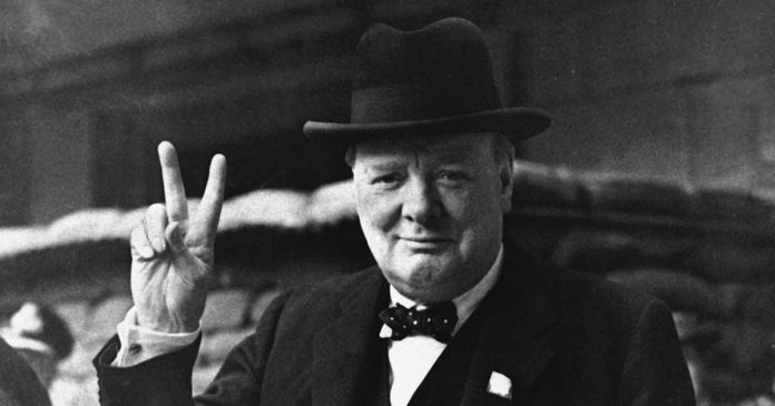 Winston Churchill giving peace sign.